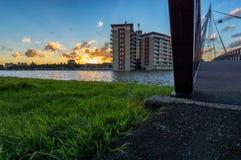 Sunset near a modern bridge. Over a river Royalty Free Stock Photo