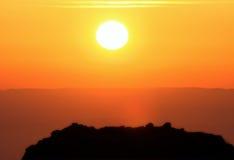 Sunset near Petra, Wadi Musa. Sunset over the hill near famous tourist destination Petra, Wadi Musa, Jordan Stock Photos
