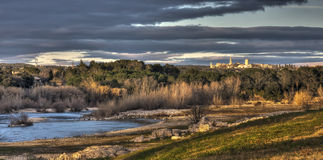 Sunset near Pont du Gard. Sunset over river near Pont du Gard in France stock images