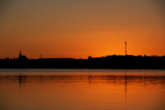 Sunset near Reykjavik with city silhouette reflecting in the wat Royalty Free Stock Image