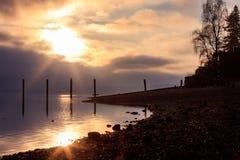 Sunset near rocky shoreline Royalty Free Stock Photography