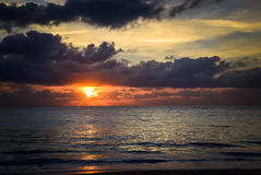 Sunset near Vero Beach, Florida. Sunset over a beach with low hanging clouds Royalty Free Stock Photo