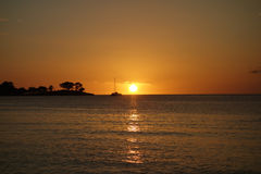 Sunset at Negril beach Jamaica. Tropical sunset in the Caribbean sea Stock Photos