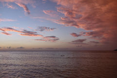 Sunset at Negril beach Jamaica. Tropical sunset in the Caribbean sea. pink clouds and sea Stock Photo