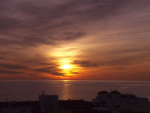 Sunset in Nerja, a resort on the Costa Del Sol  near Malaga, Andalucia, Spain, Europe. Dramatic Sunset in Nerja, a sleepy Spanish Holiday resort on the Costa Del Royalty Free Stock Image