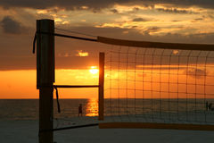 Sunset in a net. Sunset in a volleyball net. Madeira Beach Florida royalty free stock images