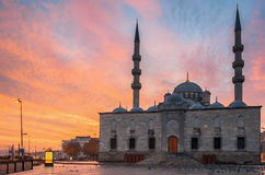 Sunset at the New Mosque (Turkish Yeni Valide Camii) historic architecture in Istanbul, Turkey Stock Photo