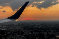 Sunset at New York City. New York City. Sunset over the Manhattan skyline from a charter flight royalty free stock image