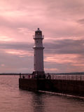 Sunset at the Newhaven Lighthouse in Edinburgh, Scotland, United Kingdom Royalty Free Stock Images