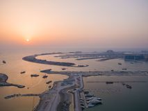Sunset and night over the artificial islands of Dubai. Timelapse. Sunset and night over the artificial islands of Dubai. Timelapse stock photography