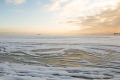 Winter sunset by the beach, ice draft royalty free stock images