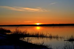 Sunset in the North of Russia. Vashka river, which flows into the White sea basin. It is good for fishing salmon. On the banks of the river is home to the Stock Photos