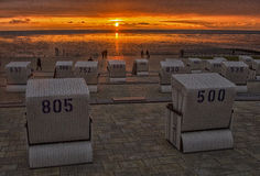 Sunset on the North Sea. The beach Sun boxes are standing on the beach at sunset Stock Photography