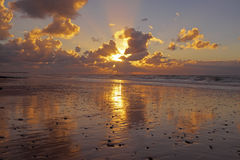 Sunset at the North Sea coast in Netherlands. Sunset at the North Sea coast in the Netherlands Royalty Free Stock Photo