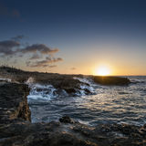 Sunset at Noth coast Curacao. Sunset at the the rocky coastline of Curacao. Nearby Playa Kanoa Royalty Free Stock Images