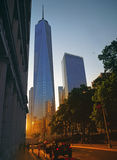 Sunset in NYC. NYC cityscape with Freedom Tower at sunset Stock Photos