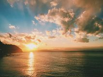 Sunset By The Ocean Royalty Free Stock Photos