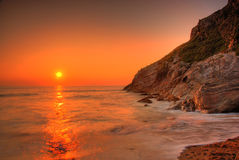Sunset by the ocean. Lusty Glaze Beach in Newquay, Cornwall, UK royalty free stock photos