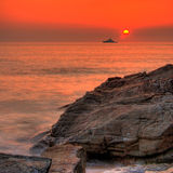 Sunset by the ocean. Lusty Glaze Beach in Newquay, Cornwall, UK royalty free stock image