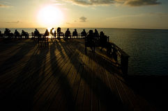Sunset at ocean. Sunset at beach bar on the seashore stock photo