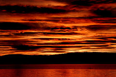 Sunset on Ocean. Oslo Fjord sunset with red glow Stock Photography