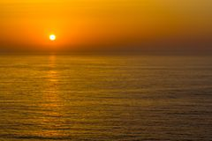 Sunset in the ocean in Arrifana Stock Photography
