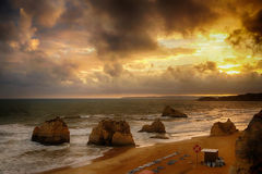 Sunset in the ocean on the beach Praia da Rocha with rock formations Royalty Free Stock Images
