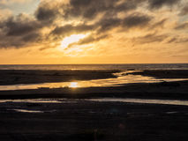 Sunset at an ocean beach Royalty Free Stock Photos