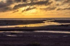 Sunset at an ocean beach Royalty Free Stock Photo