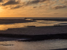 Sunset at an ocean beach Royalty Free Stock Photography