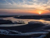 Sunset at an ocean beach Stock Image