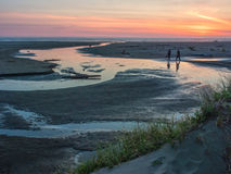 Sunset at an ocean beach Stock Images
