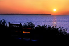 Sunset ocean bench Royalty Free Stock Images