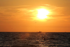Sunset on the ocean. Boat at sunset on the ocean Stock Photo