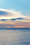 Sunset on the ocean. With boat and islands royalty free stock images