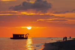 Sunset in the ocean. Dredge on a background of a sunset near the beach of the island Royalty Free Stock Photos