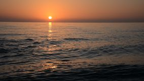 Sunset on ocean Stock Photography