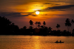 Sunset Ocean With Palm Trees Silhouette. And Boat Royalty Free Stock Images