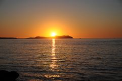 Sunset ocean panorama view in Ibiza Balearic Islands Soain. Epic summer sunset vibes over the Mediterranean sea in Ibiza, Spain Royalty Free Stock Images