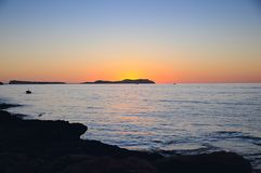 Sunset ocean panorama view in Ibiza Balearic Islands Soain. Epic summer sunset vibes over the Mediterranean sea in Ibiza, Spain Royalty Free Stock Photo