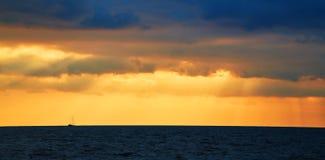 Free Sunset. Ocean Scenery. Virgin Nature Landscape. Beautiful Golden Sky. Calming Water. Open Sea. Floating Boat On Horizon Stock Photography - 194630072