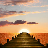 Sunset ocean scenery with wooden boardwalk. To the endless horizon Royalty Free Stock Photo