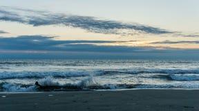 Sunset on ocean shore waves on water. Stock Photo