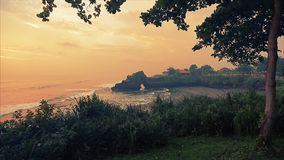 Sunset in the ocean at the Tanah Lot Temple stock footage