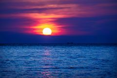 Sunset into the ocean with two ships in the horizont, Koh Rong Sanloem, Cambodia, Asia royalty free stock photos