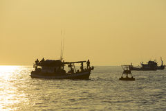 Sunset with ocean view and fishing-boats in Koh Rong. Cambodia Royalty Free Stock Images