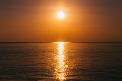 Sunset at ocean view, sun reflected on water. Sunrise at ocean view, sun reflected on water Stock Photo