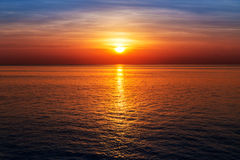 Sunset at ocean view, sun reflected on water. Sunrise at ocean view, sun reflected on water Royalty Free Stock Image