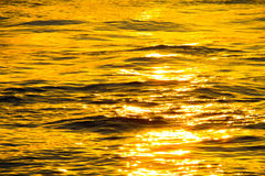 Sunset at the ocean waves Royalty Free Stock Image