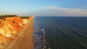 Sunset at oceanside cliffs beach aerial Portugal Algarve aerial view stock footage